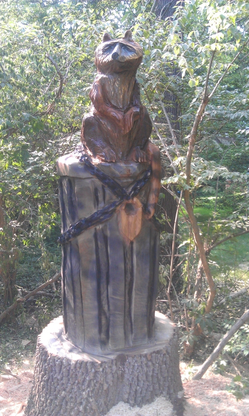 Have a tree chainsaw carved in your yard crystal city