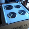 New General Electric built in white stove w/oven